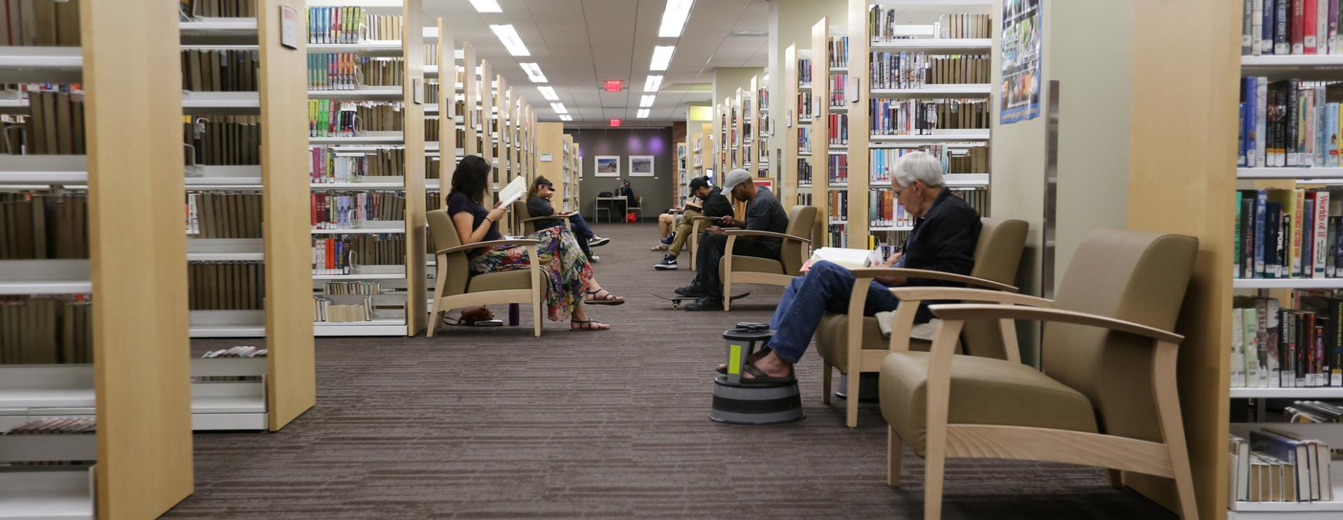 Inside the Tempe Public Library, people reading